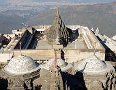 Jain temple complex on the holy Girnar hill near the Junagadh city in Gujarat. India poster
