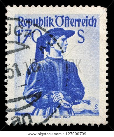 ZAGREB, CROATIA - SEPTEMBER 13: a stamp printed in the Austria shows Woman from East Tyrol, Kals, Regional Costume, circa 1950, on September 13, 2014, Zagreb, Croatia
