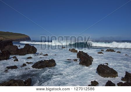 Waves coming ashore on the rocky coast of Easter Island (Papa Nui) in the Pacific Ocean