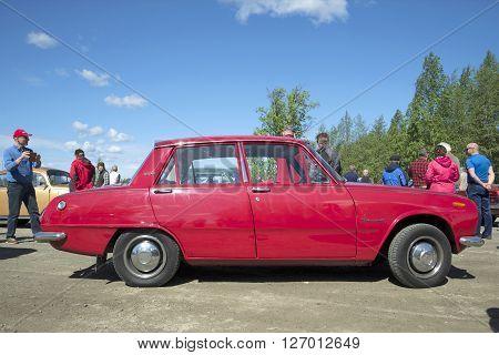 KERIMYAKI, FINLAND - JUNE 06, 2015: Four-door sedan Isuzu Bellett on the parade of vintage vehicles