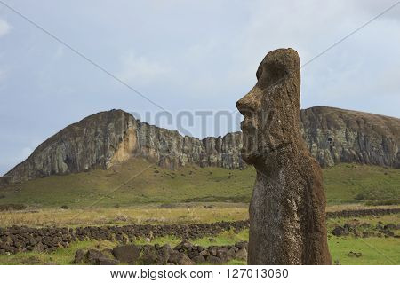 Ahu Tongariki. Ancient Moai statue on the coast of Rapa Nui (Easter Island). In the background is Rano Raraku, from where the statues were carved.
