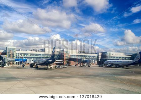 YEKATERINBURG RUSSIA - AUGUST 27 2013. The aircrafts of Aeroflot and Ural Airlines aviation companies standing at the territory of Koltsovo International airport