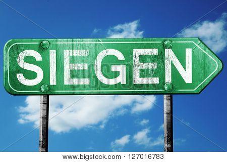Siegen road sign, on a blue sky background