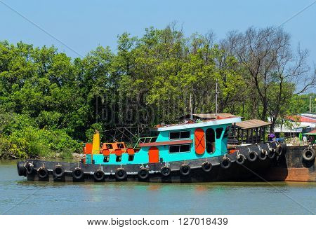 Green small ship at dock, Chonburi Thailand