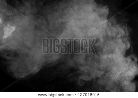 Abstract art. Grey smoke hookah on a black background. Inhalation. Steam Generator. The concept of aromatherapy. poster