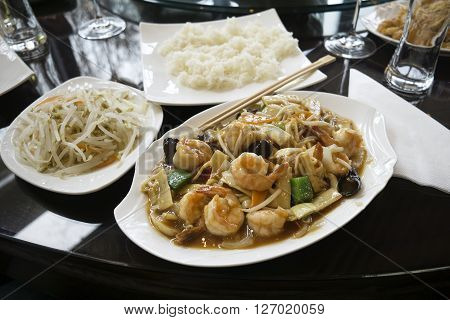 Chinese food - stir fry shrimps with vegetables and mushrooms.