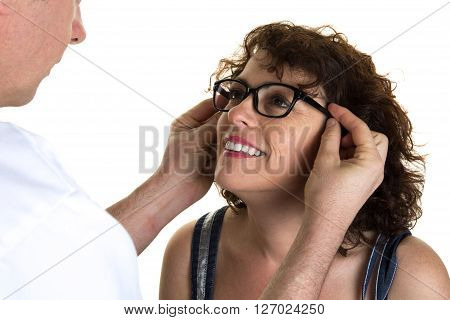 Optician Putting Glasses To Customer At Optics Store Isolated