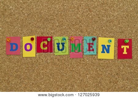 Document word written on colorful notes pinned on cork board.