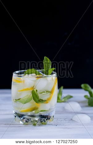 Glass With Ice, Lemon And Mint Cocktail