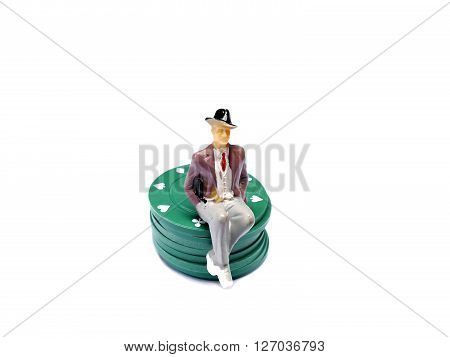 Miniature Man Sitting On Poker Chips Isolated On White With Room For Copy Space, Gambling Concept