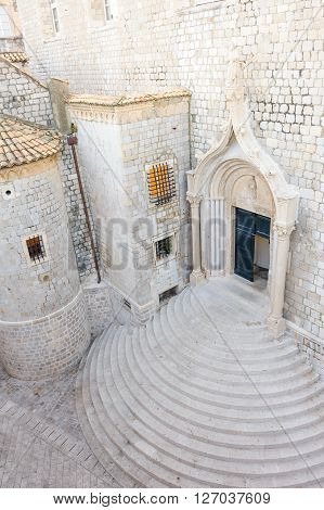 DUBROVNIK, CROATIA - AUGUST 31, 2009: Half-circular staircase and gothic ogee arched south entrance to the Dominican monastery