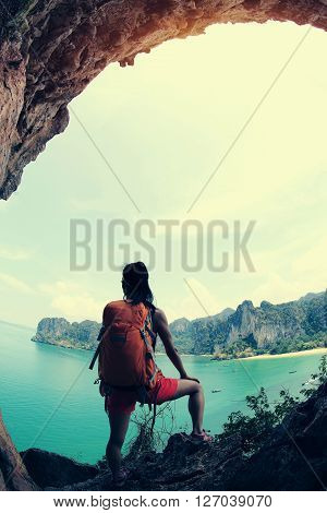 young woman hiker enjoy the view on seaside mountain top