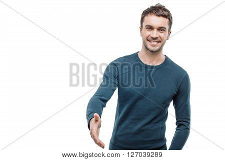 Portrait of stylish handsome young man isolated on white background. Man smiling, ready to shake hands and looking at camera. Free space for logo