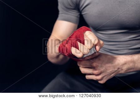 Boxer is prepairing to fight Fists of fighter before the fight or training in sport gym.