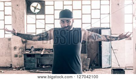 Portrait of the tattooed man with open hands