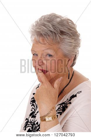 A retired senior woman looking at the camera in a sceptical look can not belief isolated for white background.
