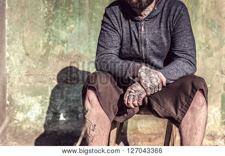 Man With Tattooes On His Hands