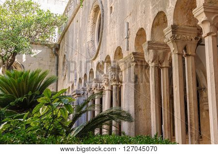 DUBROVNIK CROATIA - SEPTEMBER 1 2009: Double column colonnades with individualized capitals along the cloister of the Franciscan monastery