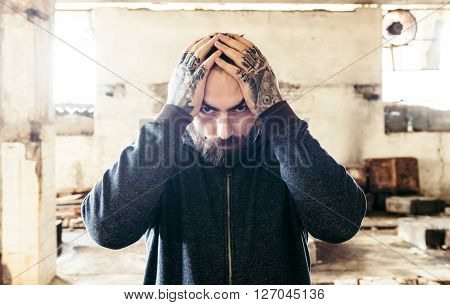 Man With Hands On Head
