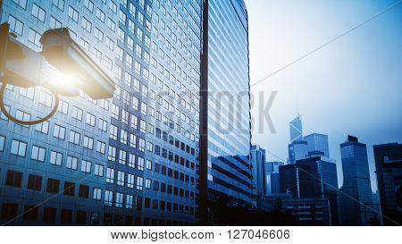 security camera in hongkong china,blue toned image.
