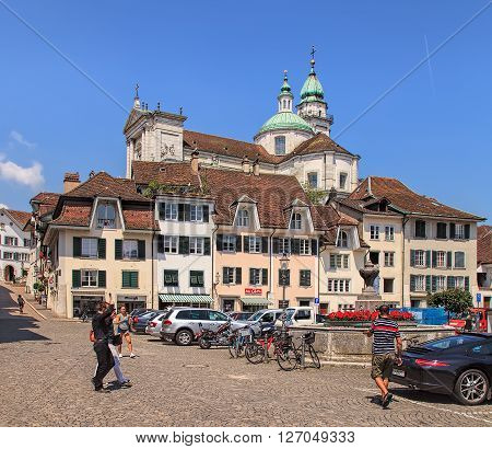 Solothurn, Switzerland - 19 July, 2013: view the old town of the city with the towers of the St. Ursus cathedral in the background. The St. Ursus Cathedral is a Swiss heritage site of national significance.
