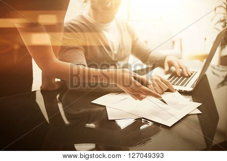 Business situation, analazy plans.Account manager working modern office with new business project. Using laptop, discussion startup, colsultation colleague.Horizontal, blurred.