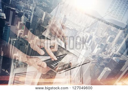 Investment department work process.Double exposure photo man showing reports modern tablet, statistics graphic screen.Private banker manager holding pen for signs documents.New business project.