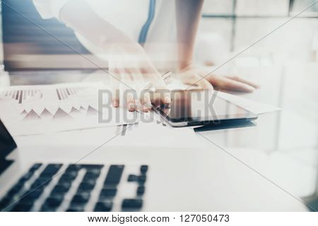 Investment manager work process.Photo business woman showing report modern tablet screen.Statistics graphic screen.Banker ready for signs document, new startup.Horizontal, bokeh and film