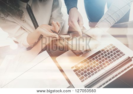 Investment managers work process.Photo man showing reports modern tablet screen.Statistics graphics screen.Private banker holding pen for signs documents.Business project startup.Film and bokeh