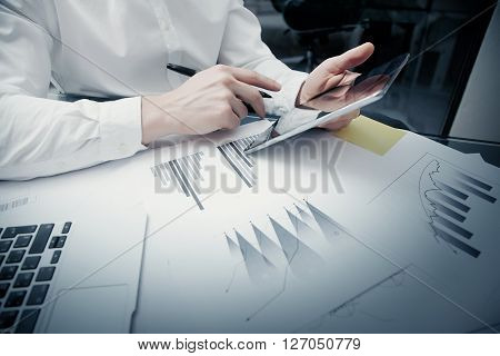Photo trader work market report modern tablet.Touching electronic device.Graphic, stock exchange rating, document  on table.Business project startup.Horizontal