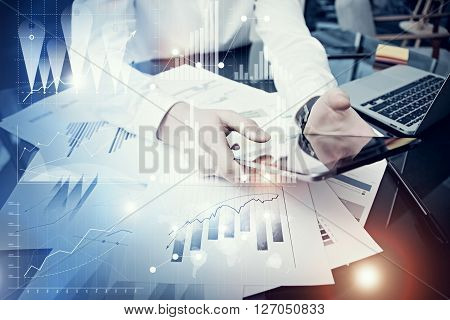 Photo man holding modern tablet screen.Using electronic device.Graphics icon, worldwide stock exchanges interface.Horizontal.Bokeh
