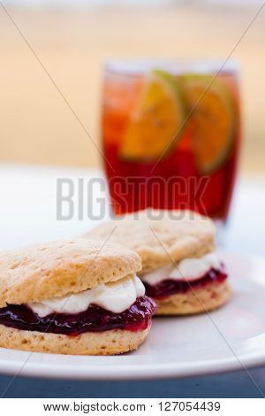 Scones With Cream And Jam And Ice Tea