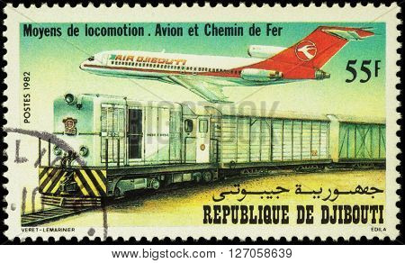 MOSCOW RUSSIA - APRIL 21 2016: A stamp printed in Djibouti shows Boeing 727-100 Airliner and Alsthom Series BB 500 Diesel Locomotive and Train series