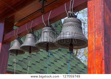 four sonorous bells hanging in the church