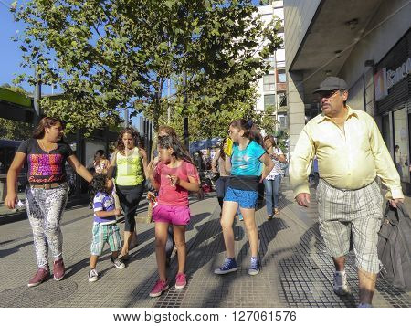 SANTIAGO DE CHILE CHILE - JAN 23 2015: family on shopping tour in the pedestrian zone downtown Santiago de Chile. Due to fastfood people have to much weight.