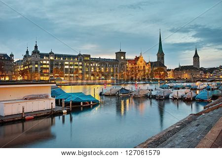 Night panoramic photo of city of Zurich and reflection in Limmat River, Switzerland