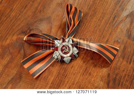 St. George's Ribbon And Order Of The Patriotic War In St. On A Wooden Background