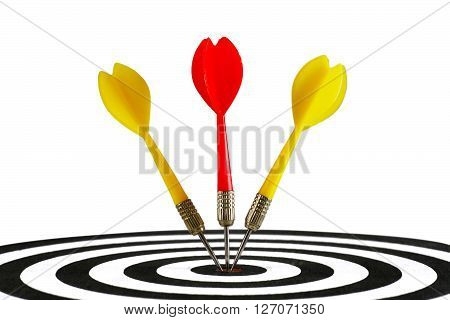 Portrait of three darts hitting the middle of dartboard isolated on white background