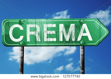 Crema road sign, on a blue sky background