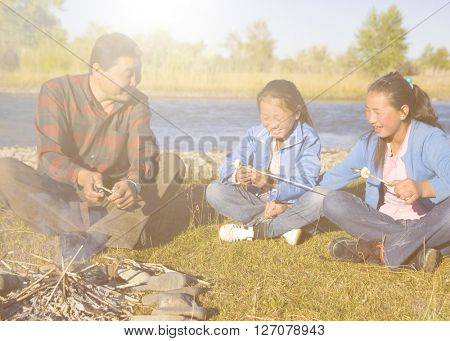 Mongolian Family Camping by The River Concept