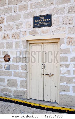 FREMANTLE,WA,AUSTRALIA-JANUARY 26,2016: The Round House tourist attraction entrance doors with limestone architecture in Fremantle, Western Australia.