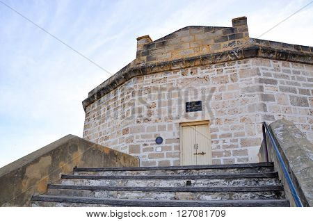 FREMANTLE,WA,AUSTRALIA-JANUARY 26,2016: The Round House tourist attraction and old gaol with limestone architecture under a blue sky in Fremantle, Western Australia.