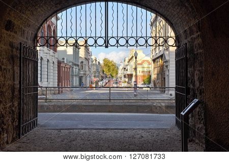 FREMANTLE,WA,AUSTRALIA-JANUARY 26,2016: Whaler's Tunnel with gate and High Street view in Fremantle, Western Australia.