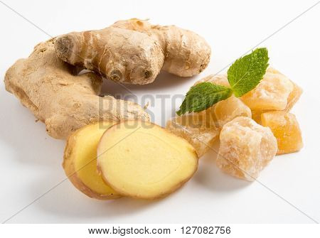 Close up of candied crystallized ginger candy pieces ginger and ginger slices isolated on white background