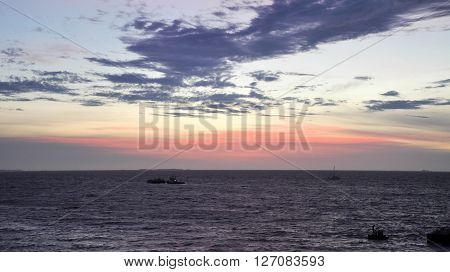 Bather's beach at twilight with a colourful sky and clouds in Fremantle, Western Australia.