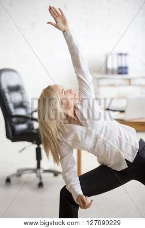 Business Woman Doing Yoga Exercise