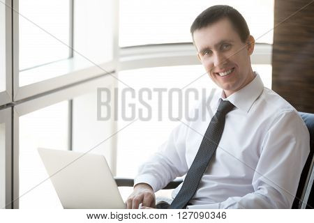 Portrait Of Friendly Businessman