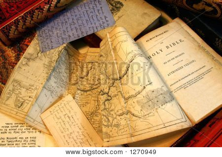 Ephemera, Old Documents, Papers, Old Books And Ephemera Scattered On A Table Top
