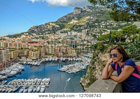 A woman dreams of yachts in Monte Carlo