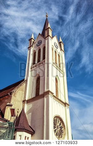 Big church in Keszthely Hungary. Architectural theme. Vertical composition. Religious architecture. Blue sky. Franciscan church. Place of worship.